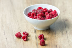 Fresh Raspberry Fruits. In White Bowl Stock Photo