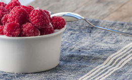 Fresh Raspberry Fruits In White Bowl. Close up Royalty Free Stock Images