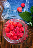 Fresh raspberry. In glass bank and on a table Stock Images