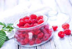 Fresh raspberry. In glass bank and on a table Royalty Free Stock Images