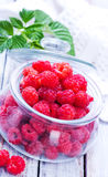 Fresh raspberry. In glass bank and on a table Royalty Free Stock Photography