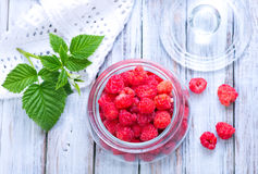 Fresh raspberry. In glass bank and on a table Royalty Free Stock Photo