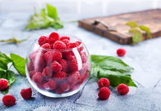 Fresh raspberry. In glass and on a table Royalty Free Stock Photos