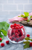 Fresh raspberry. In glass and on a table Stock Image