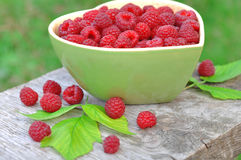 Fresh raspberry in green bowl. Raspberry in bowl in the form of heart Stock Photos
