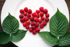 Fresh raspberry in the heart shape Stock Images