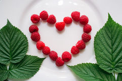 Fresh raspberry in the heart shape Stock Image
