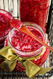 Fresh Raspberry Jam in a jars with spoon Stock Photography