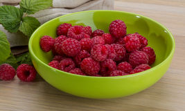 Fresh raspberry. With leaf in the bowl Royalty Free Stock Images