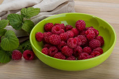 Fresh raspberry. With leaf in the bowl Stock Images