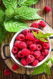 Fresh raspberry with leaves. On wooden table Stock Photography