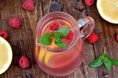 Fresh raspberry lemonade with mint in a pitcher. On table Royalty Free Stock Images