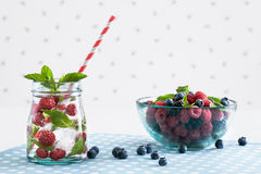Fresh raspberry mojito. With berries on a white polka-dotted background Stock Photo