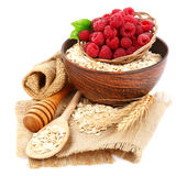 Fresh raspberry and Oatmeal flakes. Healthy food. Fresh raspberry and Oatmeal flakes isolated on white background. Healthy food Stock Image