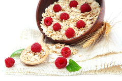 Fresh raspberry and Oatmeal flakes. Healthy food. Fresh raspberry and Oatmeal flakes isolated on white background. Healthy food Royalty Free Stock Images