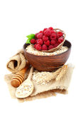 Fresh raspberry and Oatmeal flakes on white background. Healthy Royalty Free Stock Image