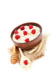Fresh raspberry and Oatmeal flakes on white background. Healthy Stock Images