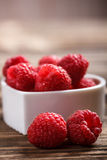Fresh raspberry. On old wooden table Royalty Free Stock Photo