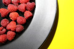 Fresh raspberry on plate Royalty Free Stock Photography