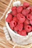 Fresh raspberry. Ripe gooseberry in wooden bucket on white Fresh raspberry in the wooden bucket Royalty Free Stock Image