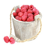 Fresh raspberry. Ripe gooseberry in wooden bucket on white Fresh raspberry in the wooden bucket Royalty Free Stock Images