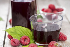 Fresh Raspberry Sirup. Fresh made Raspberry Sirup with fresh fruits (close-up shot Stock Photos