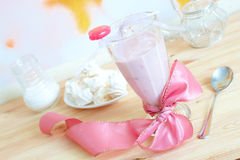 Fresh raspberry smoothie. With sweet lollipop and meringues in background. Fruit cocktail is a light drink made of milk and raspberries, strawberries and other Royalty Free Stock Photos