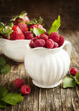 Fresh raspberry and strawberry. In bowl Stock Photo
