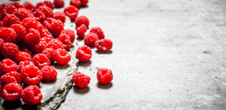 Fresh raspberry on table . On a stone background Stock Photos