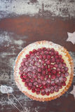 Fresh Raspberry Tart. Delicious raspberry tart with with flaked almonds and fresh raspberries for Christmas. Top view, vintage toned Stock Photos