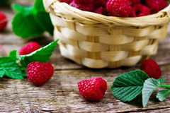 Fresh raspberry in to the basket. Style rustic. selective focus Royalty Free Stock Photo