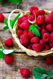 Fresh raspberry in to the basket. Style rustic. selective focus Stock Image