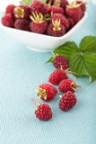 Fresh raspberry. In a white bowl on wooden table Stock Photo