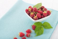 Fresh raspberry. In a white bowl on wooden table Royalty Free Stock Photography