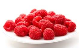Fresh raspberry. On white plate Stock Photos