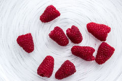 Fresh raspberry  on white plate. Collection Stock Photos