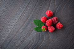 Fresh  raspberry. On wood background Royalty Free Stock Photo