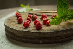 Fresh raspberry. On a wooden background Stock Photos