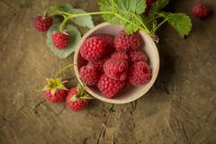 Fresh raspberry. On a wooden background Stock Photo