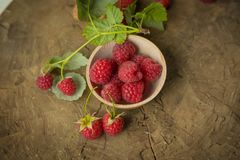 Fresh raspberry. On a wooden background Royalty Free Stock Images
