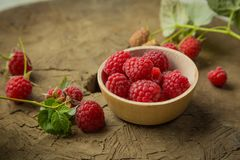 Fresh raspberry. On a wooden background Royalty Free Stock Photos