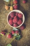 Fresh raspberry. On a wooden background Royalty Free Stock Photo