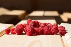 Fresh raspberry on wooden boards Stock Photo
