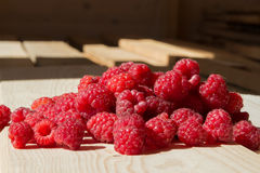 Fresh raspberry on wooden boards Stock Images
