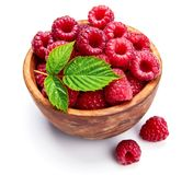 Fresh raspberry in wooden dish with green. Leaf vegan food Fruits and berries, isolated on white background Royalty Free Stock Photography