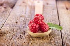 Fresh raspberry in wooden spoon Royalty Free Stock Photos