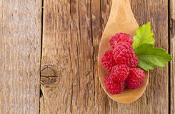 Fresh raspberry in wooden spoon Royalty Free Stock Image