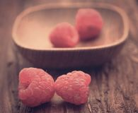 Fresh Raspberry. On wooden surface Stock Photo