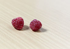 Fresh raspberry. On wooden table Stock Photography