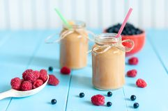 Fresh rastberry, blueberry and banana juice in jam Royalty Free Stock Photos